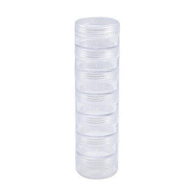 Seven Stacked Threaded Round Storage Jars